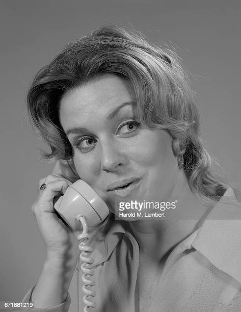 young woman talking on telephone - number of people stock pictures, royalty-free photos & images