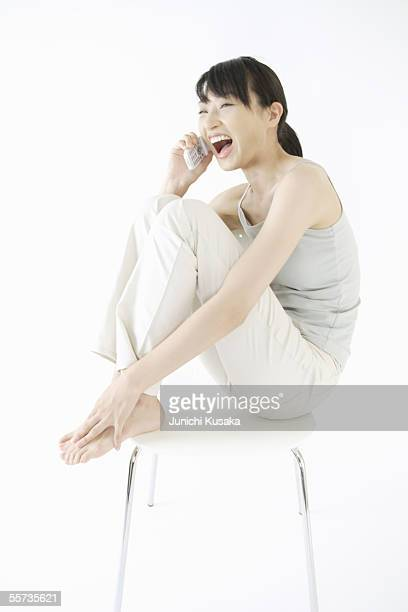 A young woman talking over a phone