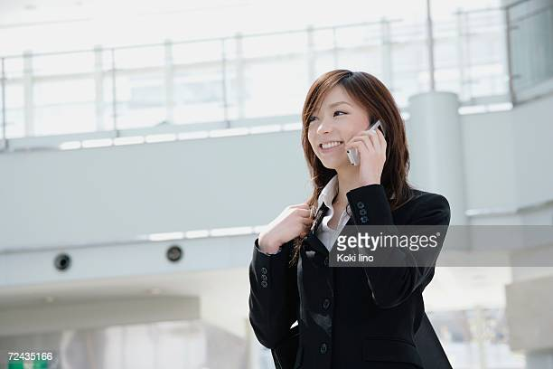 A young woman talking over mobile phone