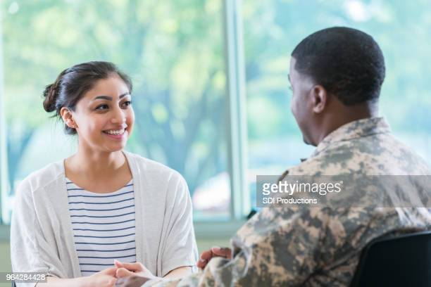 young woman talks with recruitment officer - civilian stock pictures, royalty-free photos & images