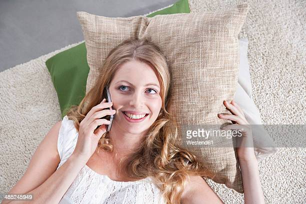 Young woman telephoning at home