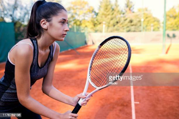 young woman tennis player - sporting term stock pictures, royalty-free photos & images