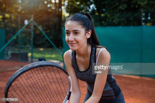 young woman tennis player - tennis player stock pictures, royalty-free photos & images
