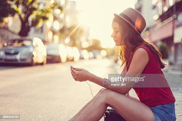 Young woman texting for Uber