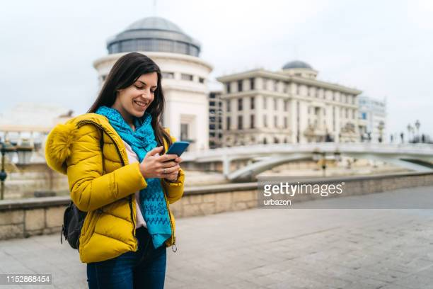 young woman texting from skopje - skopje stock pictures, royalty-free photos & images