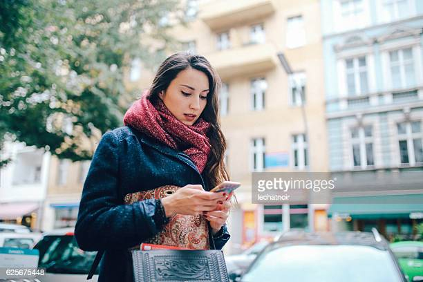 Young woman texting in Berlin