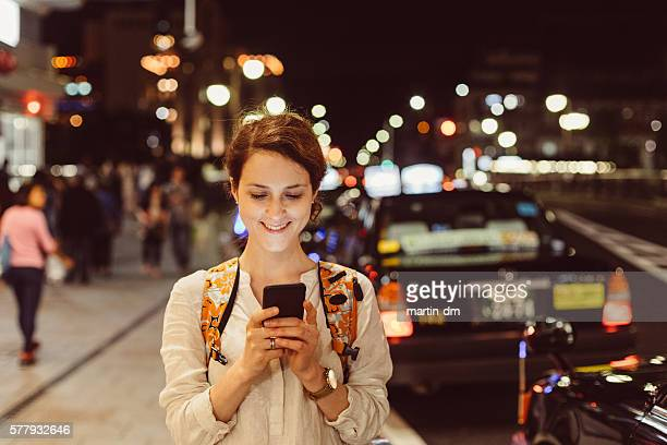 Young woman texting in the city