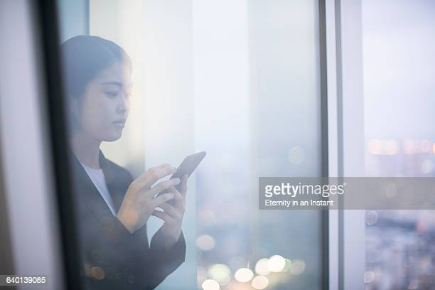 Young woman texting on her phone