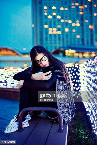 Young woman texting on the phone outside in Tokyo