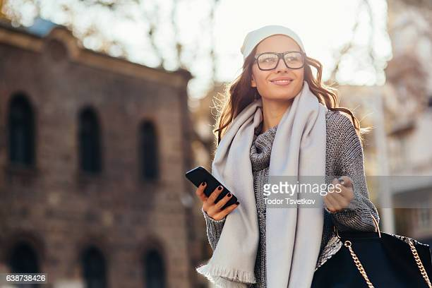 young woman texting outdoors - spectacles stock pictures, royalty-free photos & images