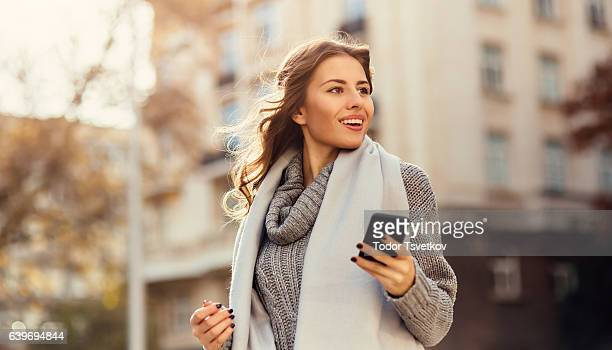 Young woman texting outdoors