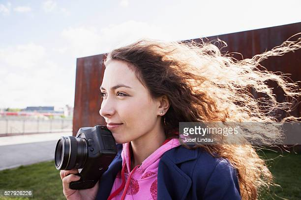 Young woman thinking about an image she wants to take