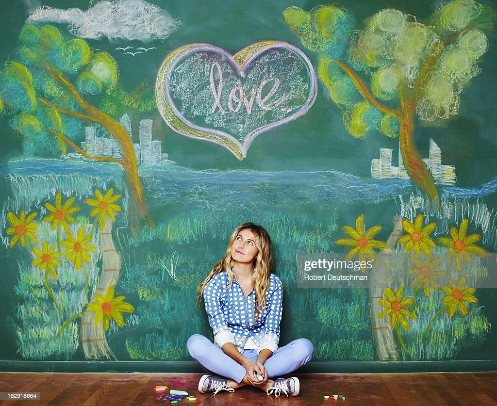 A young woman thinking about love. : Stock Photo