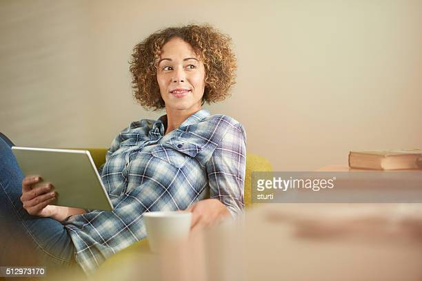 young woman thinking with her tablet