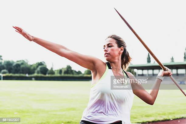 young woman throwing javelin - women's field event stock pictures, royalty-free photos & images