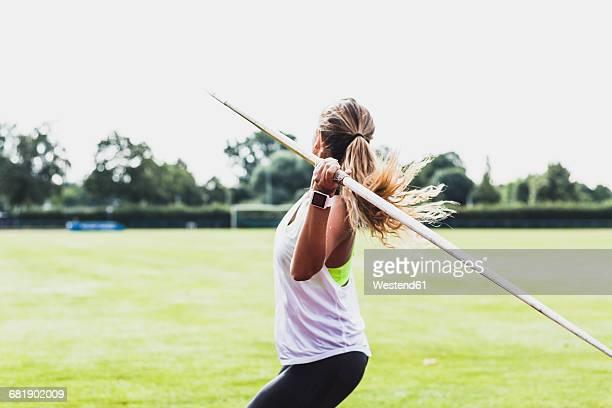young woman throwing javelin - やり投げ ストックフォトと画像