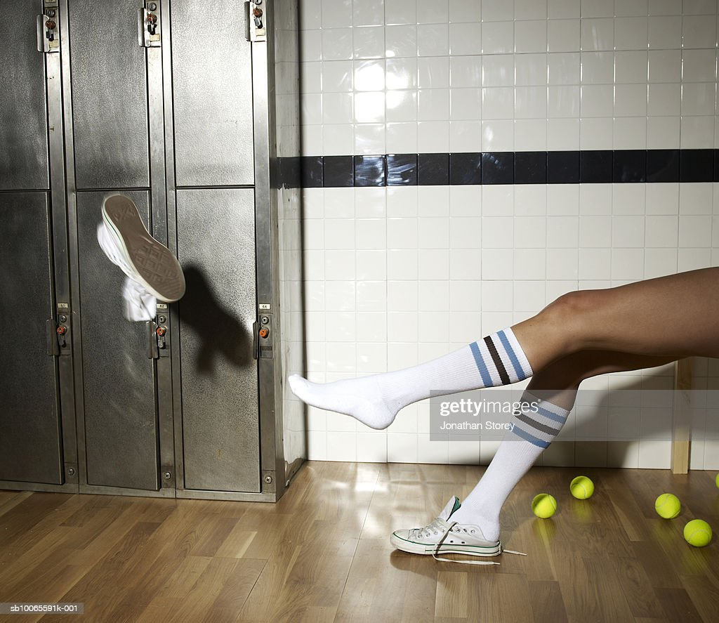Young Woman Throwing Shoes In Locker Room Stock Photo Getty Images