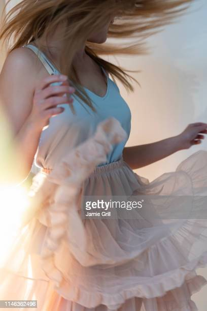 young woman tossing her head while dancing - up skirts stock pictures, royalty-free photos & images