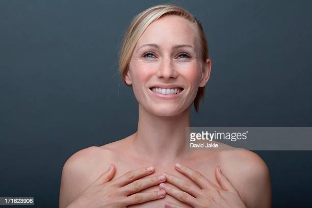 young woman touching chest - oben ohne frau stock-fotos und bilder