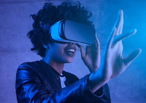young woman touching experiencing VR helmet. 1124742848