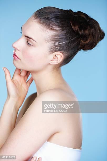 young woman touching her cheek, side view - 頬 ストックフォトと画像