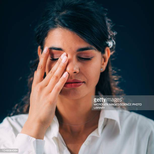 young woman touching her eyes - touching stock pictures, royalty-free photos & images