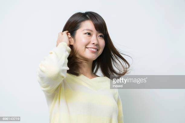 young woman touching her hair - 髪に手をやる ストックフォトと画像
