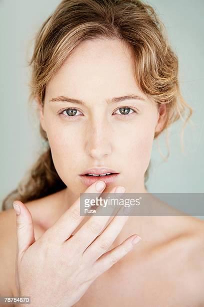 Young Woman Touching Lips