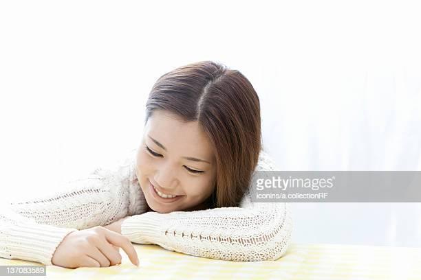 Young woman touching the table, Tokyo Prefecture, Honshu, Japan