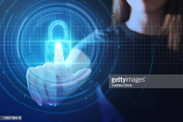 young woman touching ui security padlock - hud interfaccia grafica utente foto e immagini stock