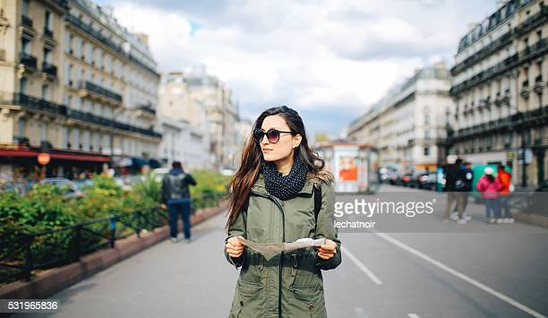 young woman tourist in paris - parka coat stock photos and pictures