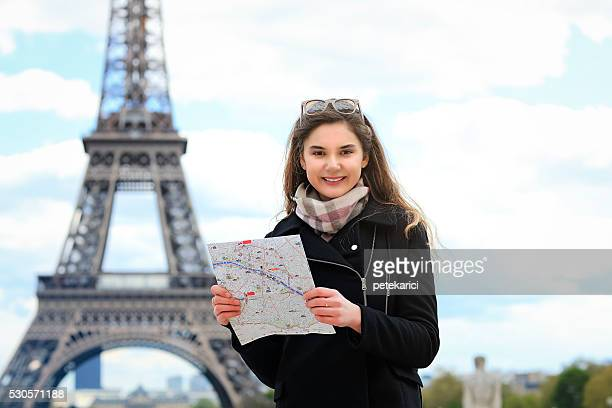 Young woman tourist smiling at Eiffel Tower Paris