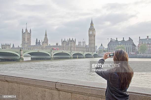 Young Woman Tourist Taking Pictures Of London Landmarks