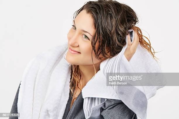 Young woman towel drying hair
