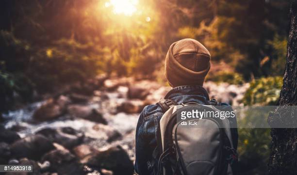 young woman  trail hiking alone in the forest at sunset - endurance stock pictures, royalty-free photos & images