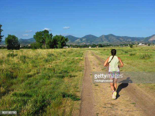 Young woman trail running Fehringer Ranch Park Morrison Colorado Rocky Mountains