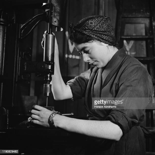 A young woman training for war work in the machine shop of the Ministry of Labour training centre at Chelsea Polytechnic later the Chelsea College of...
