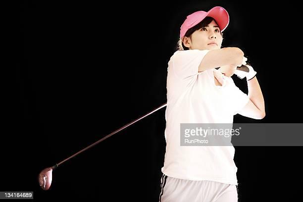 young woman training ,golf - 女子 ゴルフ ストックフォトと画像