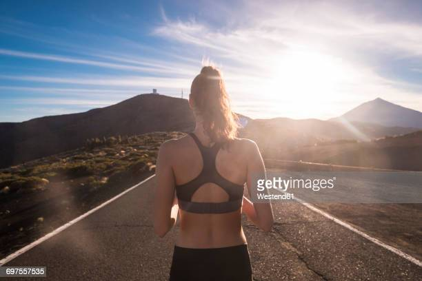 young woman training on empty street - empty road stock pictures, royalty-free photos & images