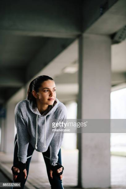 young woman training outdoors - sweatshirt stock pictures, royalty-free photos & images