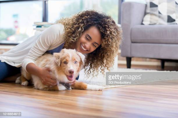 young woman training puppy - pet owner stock pictures, royalty-free photos & images