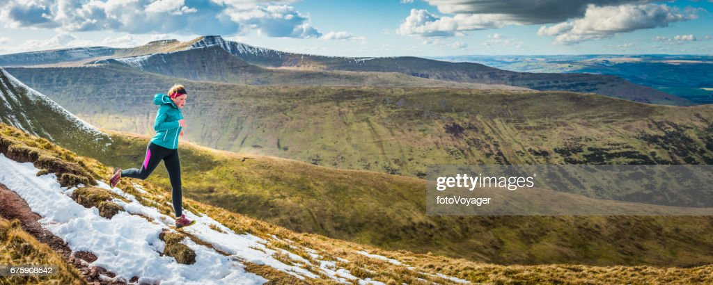 Young Woman Training Trail Running Along Mountain Ridge Wilderness Panorama High Res Stock Photo Getty Images