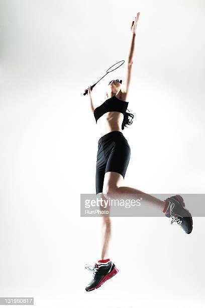 young woman training,badminton - スポーツ バドミントン ストックフォトと画像