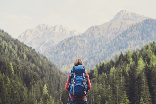Young woman traveler in a mountains 1058667408