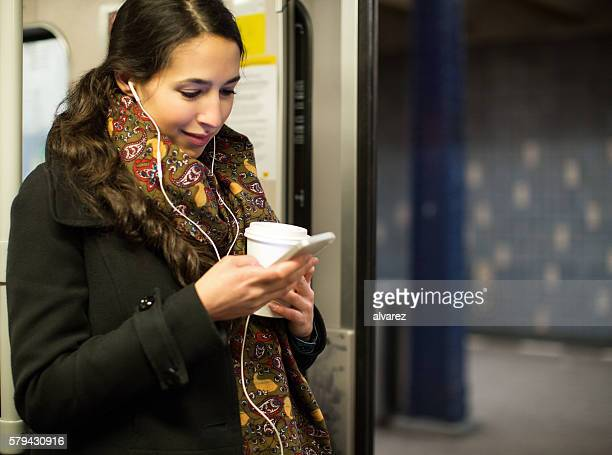 Young woman traveling by a train