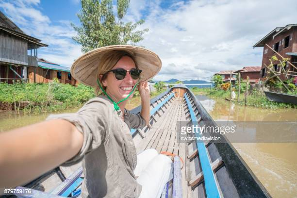 young woman traveling in asia takes selfie portrait, taxi boat - one young woman only stock pictures, royalty-free photos & images