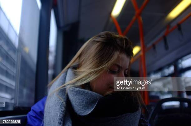 Young Woman Traveling In Bus