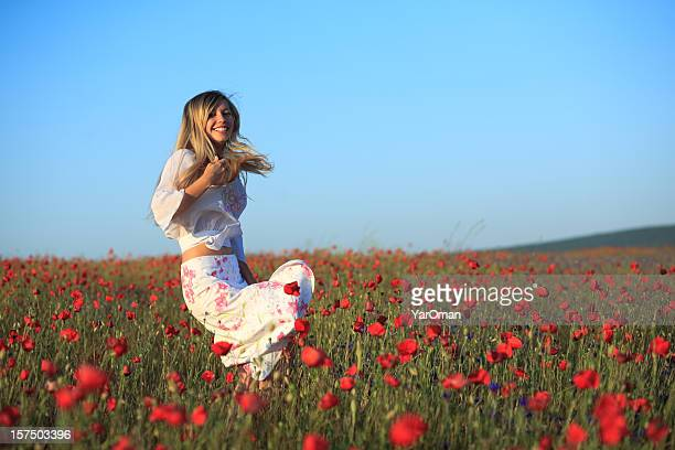 young woman traveling in poppy field