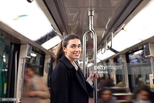 young woman travelling in a train of parisian underground - railroad car stock pictures, royalty-free photos & images