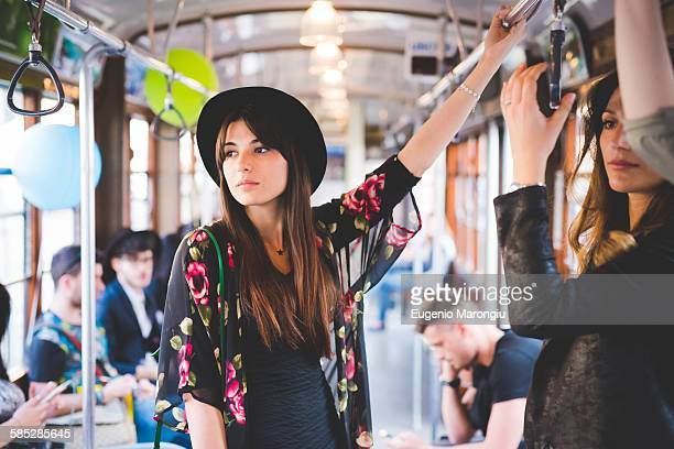 Young woman travelling on city tram